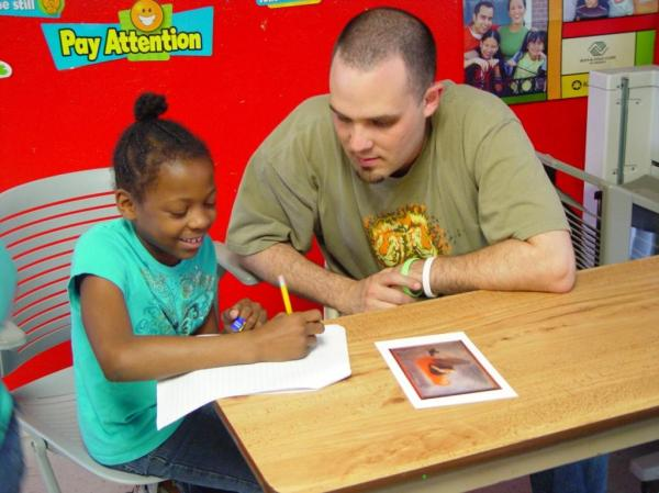 Will works with a student at Westlake Village Boys & Girls Club.
