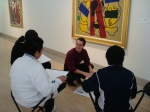 Justin Greenlee in the galleries with students from W. E. Greiner Exploratory ArtsAcademy