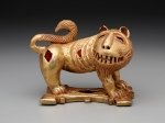 Sword ornament in the form of a lion, Ghana: Nsuta State, Asante people, c. mid-20th century, cast gold and felt, The Eugene and Margaret McDermott Art Fund, Inc.,2010.2.McD
