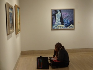 Family completing a writing activity in the American Art gallery.