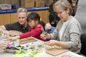 Visitors exploring art materials in the Studio