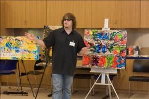 Artist John Bramblitt talks about his artwork during an Art Beyond Sight access program.