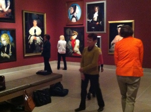 Docents walking like figures from Cindy Sherman's History Portraits