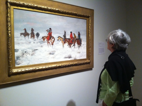 Docent Judy Butts examines Charles Marion Russell's Lost in a Snowstorm