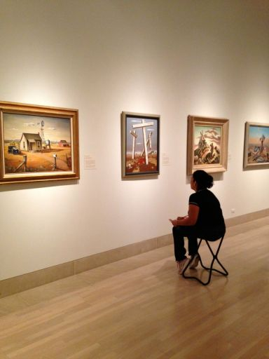 Bety contemplates a 20th-century American painting she has selected for the tour.
