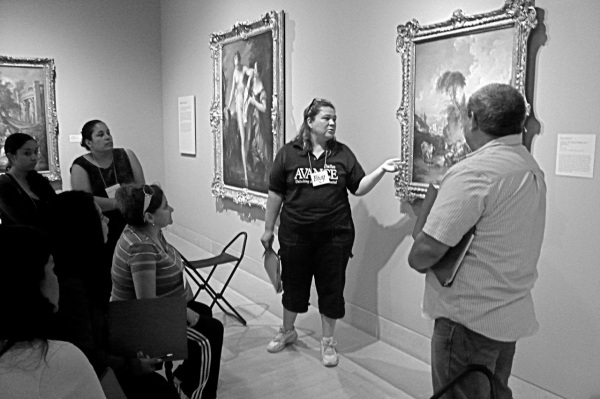 Rosy shares her insights about an 18th-century European painting during a group exercise early in the program.