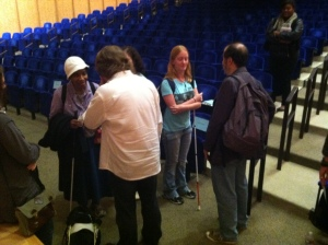 Visitors with vision impairment talking with John Bramblitt and Stephen Lapthisophon after their Late Night artist lecture