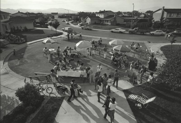 This is our second annual Fourth of July block party. This year thirty-three families came for beer, barbequed chicken, corn on the cob, potato salad, green salad, macaroni salad, and watermelon. After eating and drinking we staged our parade and fireworks., Bill Owens, 1971