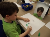 Drawing self-portraits in the studio