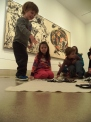 "Pretending to ""paint"" like Jackson Pollock with yarn"
