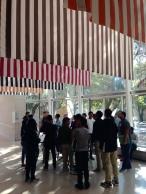 Students talking about Buren's 'Sanction of the Museum'.