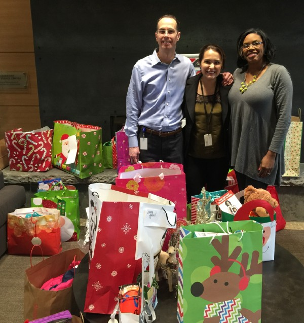 Andrea dropping off gifts with CASA Staff