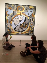 McDermott Interns exploring activities with Gerald Murphy's Watch (1925, Dallas Museum of Art, Foundation for the Arts Collection, gift of the artist, 1963.75FA)