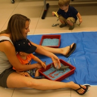 Sensory play in the studio with colored rice and sea creature toys