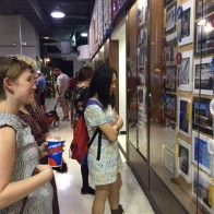 Jessie Frazier and McDermott Interns Emily Wiskera and Jenny Wang look at some of the many photography entries on view. So many talented artists entered the competition this year!