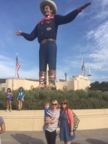 Sarah Coffey, her son Rhys, and Madeleine Fitzgerald pose in front of Big Tex, the State Fair of Texas's larger-than-life mascot! He moves and talks too, which only slightly spooked us.