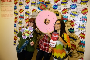 Educators enjoying the Pop-themed photo booth
