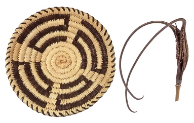 The slender horns of the devil's claw pod (right) produce the black designs in this Papago basket. Copyright W. P. Armstrong