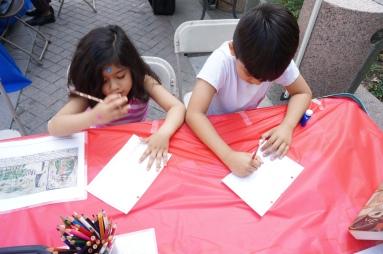 Visitors creating exvotos at AVANCE Latino Festival.