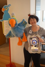 Arturo and his robot companion greeting visitors at First Tuesday