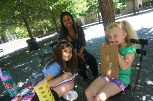 Vanessa and campers take a sketching break at lunch.