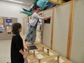 Shannon and Julia set up for an end of camp art exhibition.