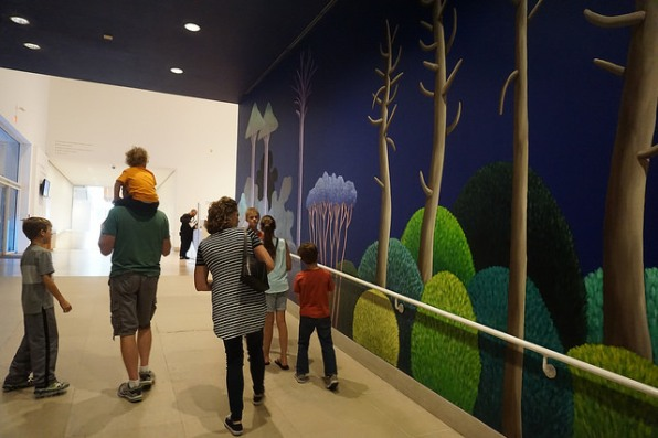 Families studying the mural