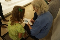 Meaningful Moments participant Sue and her granddaughter work on an activity in the galleries.