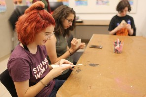 Lisa Huffaker led a zinemaking activity inspired by her Visiting Artist Project. Teen Ambassador Courtney took the night off volunteering to enjoy the workshop with a friend.
